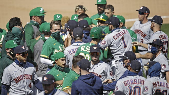 The players scuffle after Oakland's Ramon Laureano was hit by a pitch thrown by Houston's Humberto Castellanos on Sunday.