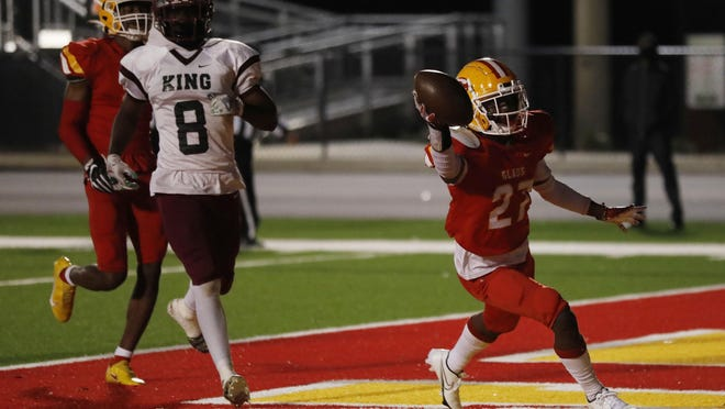 Clarke Central's Felix Braddy Jr. (27) celebrates after scoring another touchdown during an GHSA high school playoff football game between Clarke Central and M.L. King in Athens, Ga., on Friday Nov. 27, 2020.