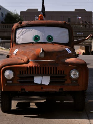 """Jerry Engelke waves to the crowd during the West Texas Fair & Rodeo parade Saturday Sept. 9, 2017. Engelke's truck is a 1950s International Harvester pickup made to resemble """"Tow Mater"""" from the movie """"Cars."""""""