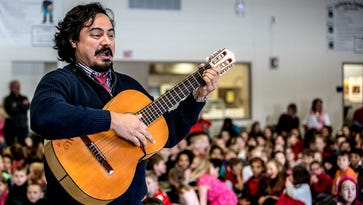 """Jesús Daniel Hernández gave a concert to students at John Clem Elementary school Friday morning. The singer talked with children about different types of folk music as well as opera. Hernández will be performing a Valentine's Day concert called """"From the Heart"""" on Saturday with the Newark Granville Symphony Orchestra Saturday night."""