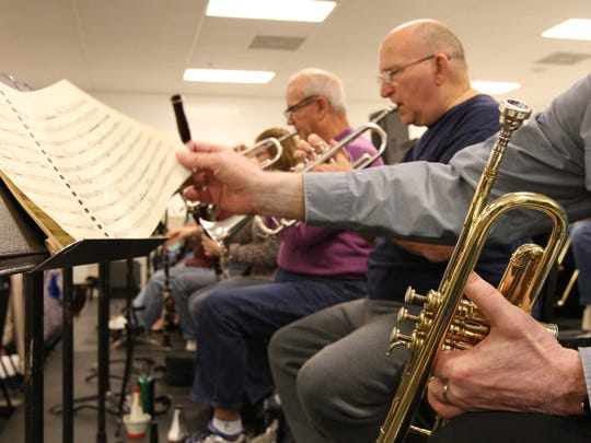 Members of Gulf Coast Symphony rehearse last year at