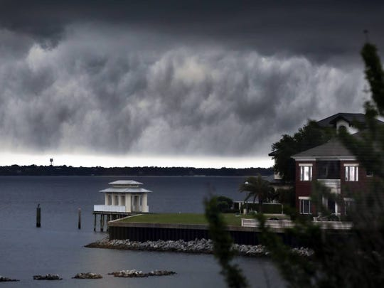 A storm rolls in Tuesday over Pensacola Bay.