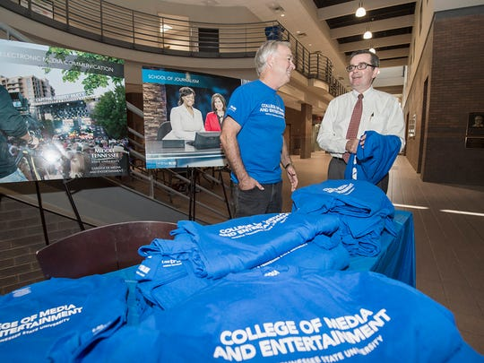 College of Media and Entertainment Ken Paulson, left, and Greg Pitts, new School of Journalism chair, chat during the College of Media and Entertainment celebration Wednesday, Aug. 26, 2015, in the Bragg Building lobby. (MTSU photo by Andy Heidt)