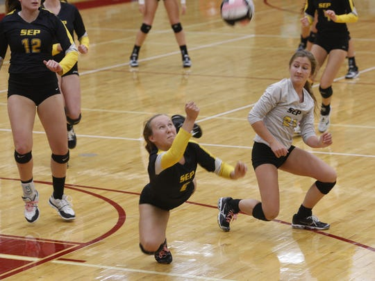 Southeast Polk setter Sammy Sixta dives to make a save during a match at Ankeny on Sept. 29. Sixta had 38 assists as the Rams posted a 25-18, 25-14, 21-25, 25-11 victory in their CIML Eastern Division opener.