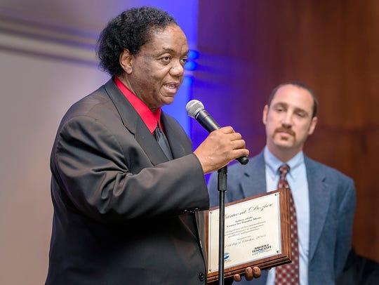 Motown music icon Lamont Dozier, left, expresses his