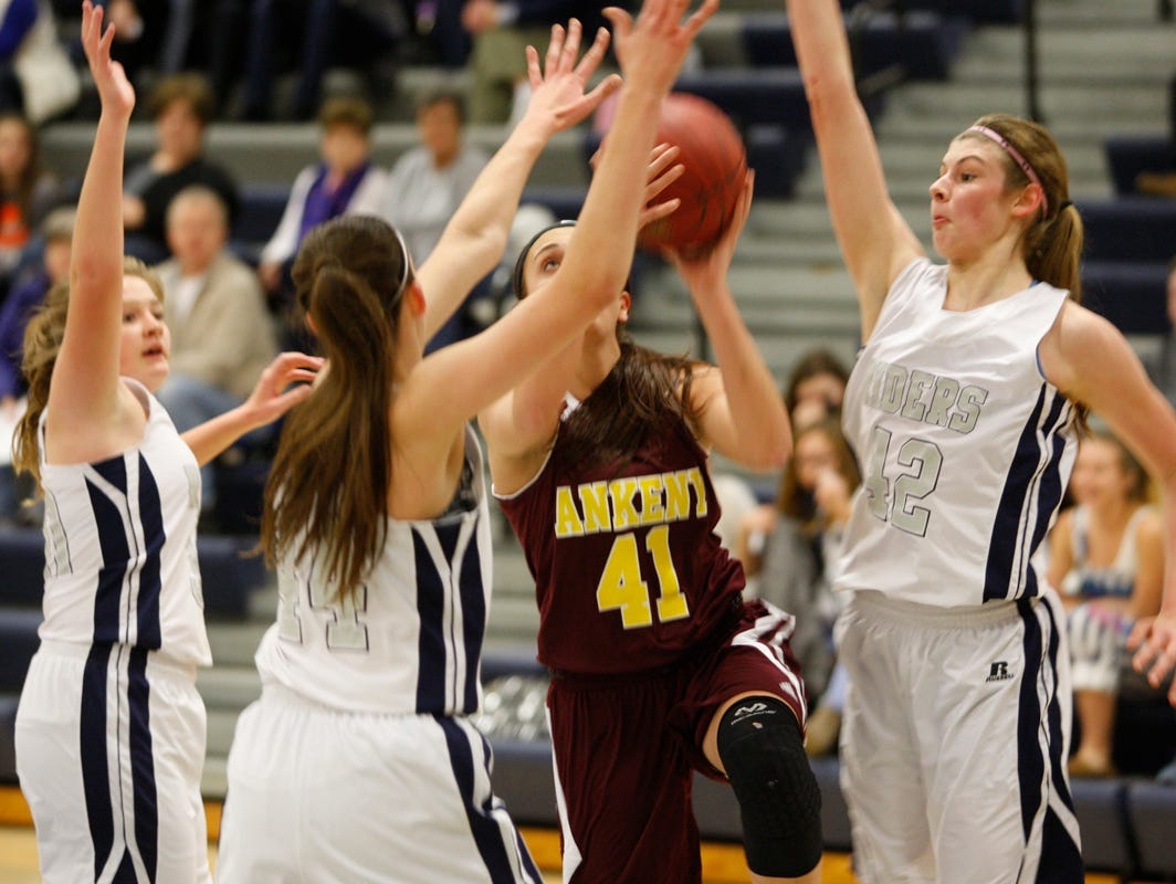 Ankeny's Hannah Shadravan goes up for a shot between three Des Moines Roosevelt defenders during a game on Dec. 1 at Roosevelt. Shadravan scored 10 points as the Hawkettes posted a 54-40 victory for their first win of the season.