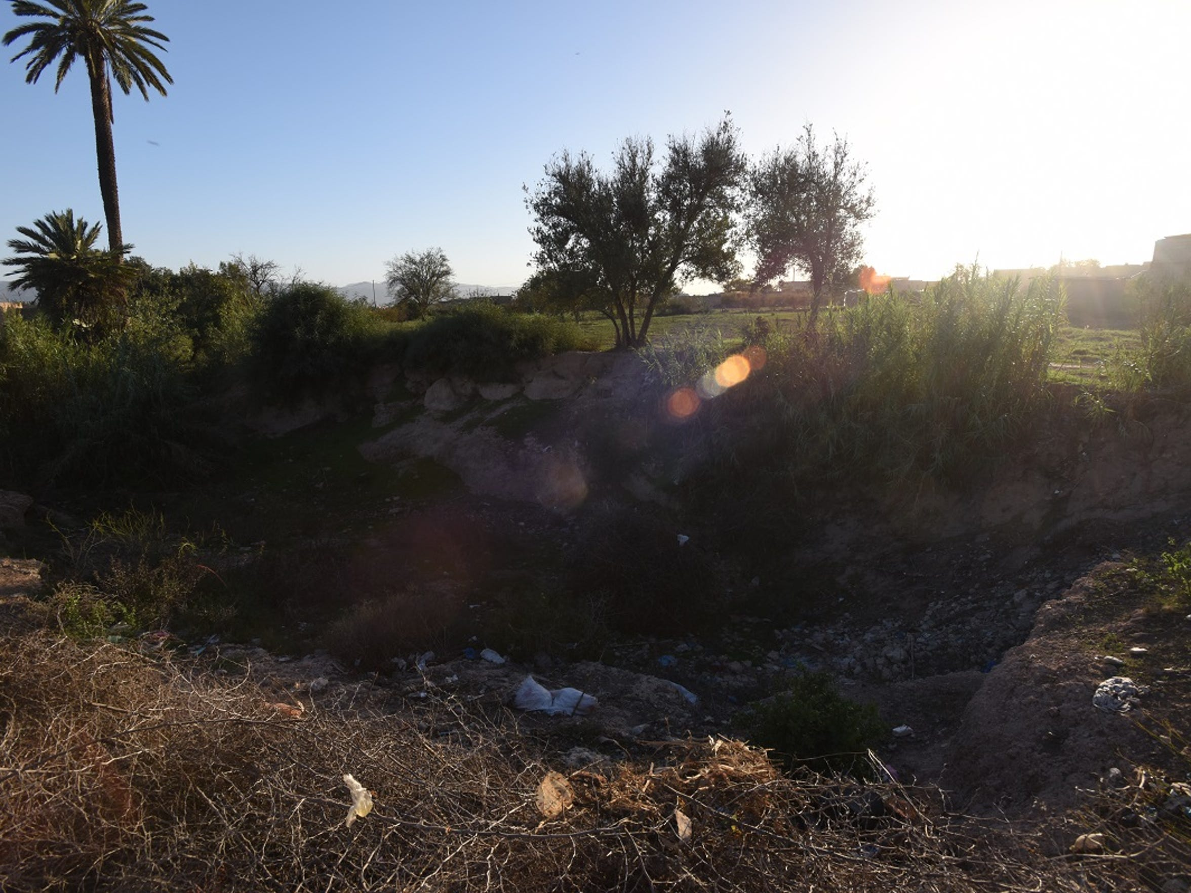 Some springs that once sustained farming villages are now dry in Morocco's Souss-Massa region. In a village near the town of Oulad Berhil, a dry spring has become a grassy pit filled with trash. People say it stopped flowing about 15 years ago.