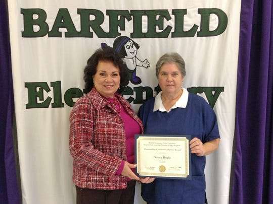 Pictured, from left, are Barfield Elementary Principal Judy Goodwin and Susan Bogle, cafeteria manager. Bogle was selected as an MTSU EXL Outstanding Community Partner Award winner for her support of MTSU's Nutrition and Food Science program.