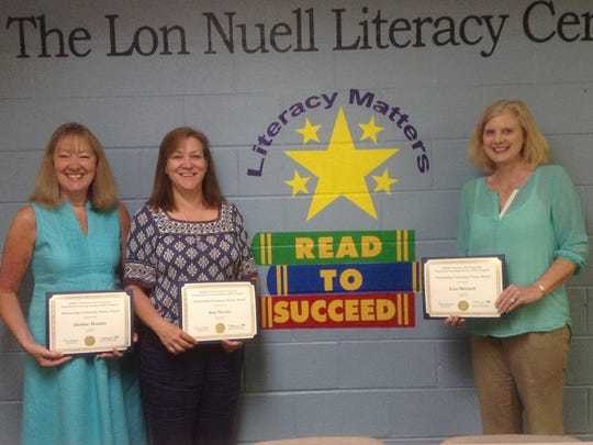 Read to Succeed received an MTSU EXL Outstanding Community Partner Award for the 2014-15 academic year. Pictured, from left, are Read to Succeed staff members Debbie Mankin, Amy Swartz and Executive Director Lisa Mitchell.