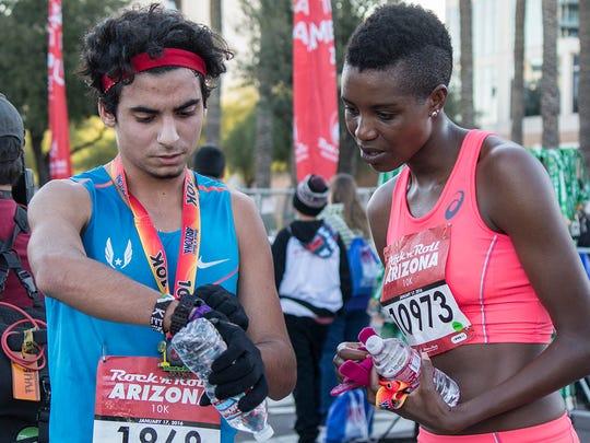 Najim Udchachon, 18, and 31-year-old Diane Nukuri, the top male and female runners at the Rock 'n' Roll Arizona Marathon 10k race.