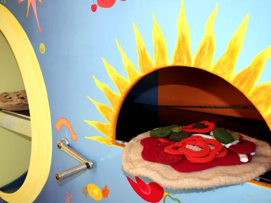 Pizza is loved by all ages. This play oven is from Madison Children's Museum.