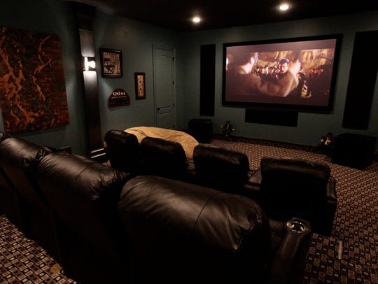 This home theater by Electronics Professionals provides
