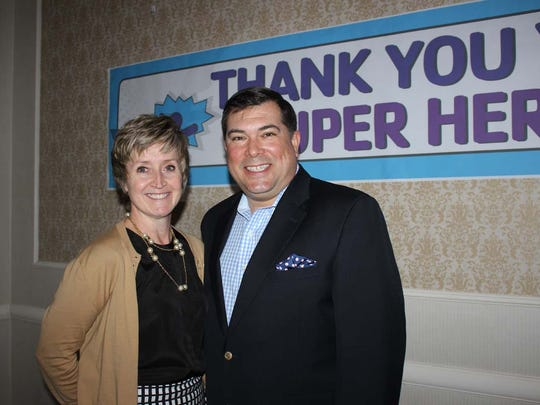Somerville and Bridgewater YMCAs' executive director Kate Russo celebrates Somerset County YMCA's Annual Campaign with Board of Managers chair Tim Foley of Bridgewater.