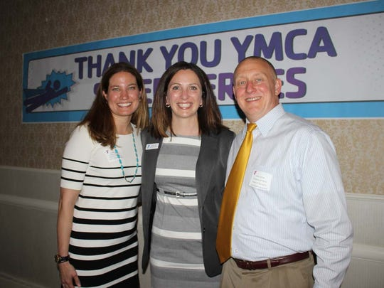 Hillsborough YMCA Board of Managers members Kristen Sudol (left) and Allen Zdroik (right) of Hillsborough celebrate the success of the Annual Campaign with executive director Kimberly Cole (center).