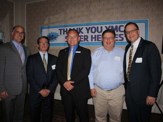 Somerset Hills YMCA Board of Mangers members Dr. Stephen Hunt and Dan McCauley, both of Basking Ridge, with executive director Marc Koch, Board of Managers member Greg Toombs of Basking Ridge and Board of Managers chair, Mike Osterman of Pottersville.