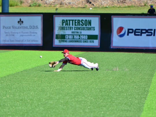 Louisiana Tech's Marshall Boggs makes a diving catch
