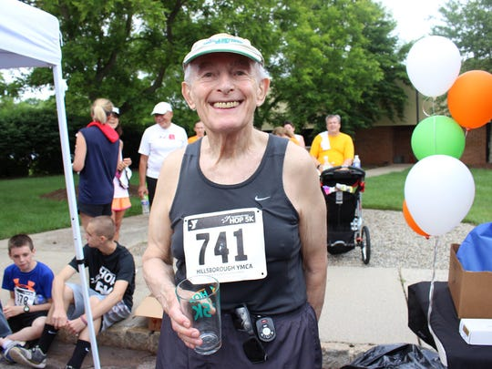 Neil Proshan, 82, of Princeton finishes Hillsborough YMCA's Hop 5K with a smile.