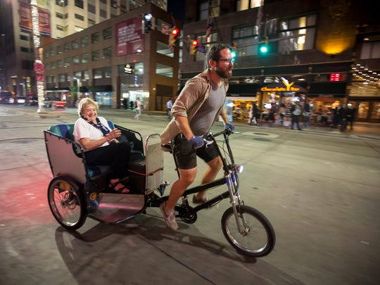 Ames gives Maggie Orchowski a ride in his pedicab.