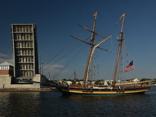 The Pride of Baltimore II navigates under the Maple-Oregon Bridge. The schooner is a reconstruction of a Baltimore Clipper in the War of 1812.