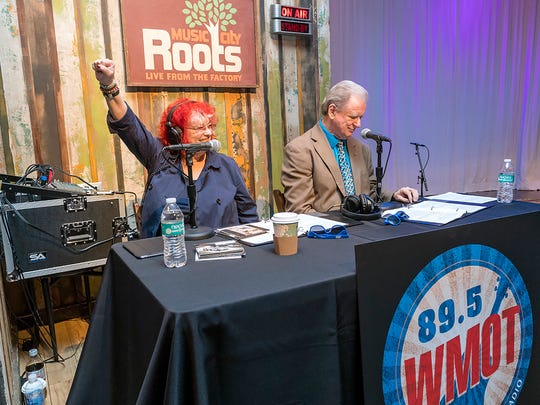 Music City Roots Program Director Jessie Scott, left, and announcer Keith Bilbrey celebrate the transition of WMOT-FM, MTSU's 100,000-watt radio station, to Americana music at a Sept. 2 ceremony at the Country Music Hall of Fame in Nashville.