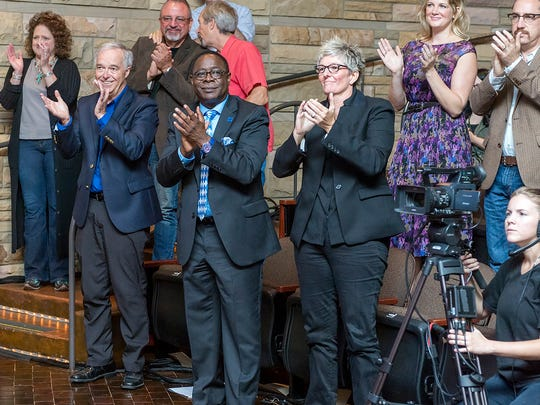 MTSU and Music City applaud Americana performers as they usher in the new WMOT-FM/Roots Radio 89.5 at a Sept. 2 ceremony at the Country Music Hall of Fame. From left, front row, are Ken Paulson, dean of the College of Media and Entertainment; MTSU President Sidney A. McPhee; and Val Hoeppner, executive director of the Center for Innovation in Media. In the second row, from left, are Laurie Gregory, senior producer for Music City Roots; John Walker, executive producer for Music City Roots; Abby White, development director for MTSU's College of Media and Entertainment; and Greg Reish, director of MTSU's Center for Popular Music.