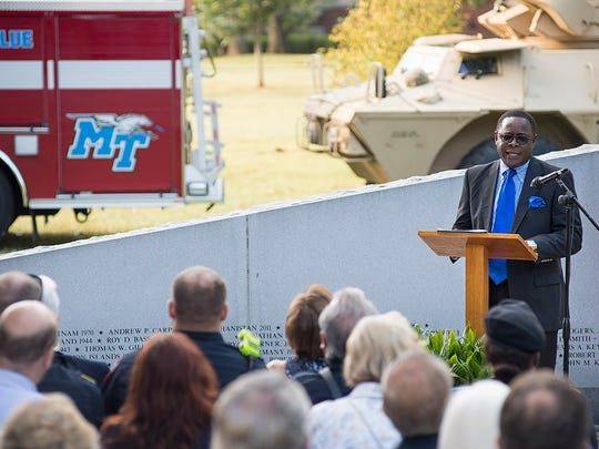 Dr. Sidney McPhee addresses the audience at MTSU's Veterans Memorial Sunday for the university's 9/11 observance.