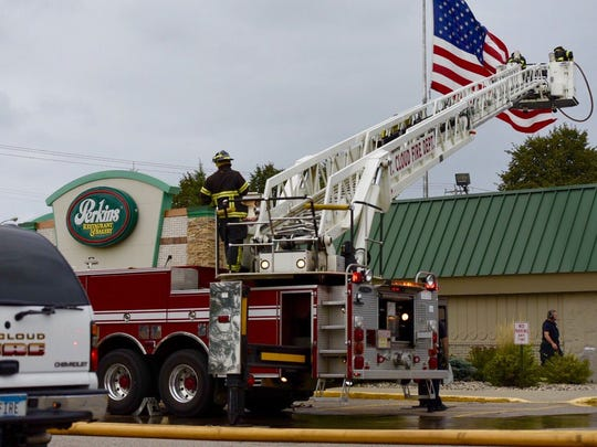 St. Cloud firefighters monitor the roof of Perkins