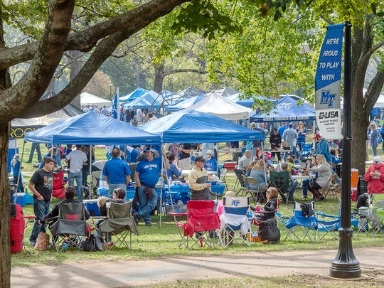 In this 2015 file photo, MTSU students, alumni and fans gather in Walnut Grove to tailgate during last year's homecoming day activities. MTSU celebrates homecoming Saturday, Oct. 15, with numerous activities.