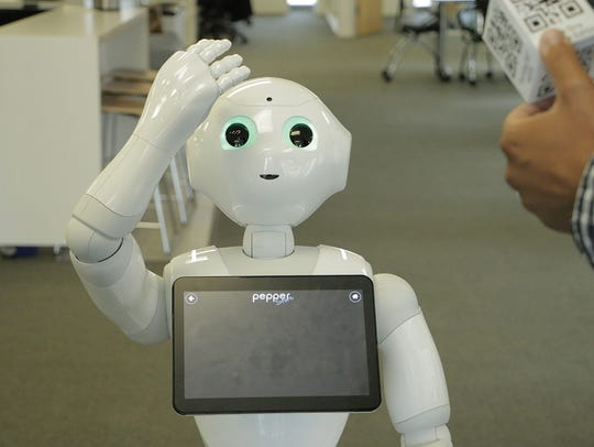 Pepper, SoftBank's humanoid robot, demonstrates how