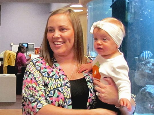 Mignon and Everleigh Miller of Rayne speak to those gathered at Women's & Children's Hospital on Thursday, Nov. 17, 2016 for the World Prematurity Awareness Day event.