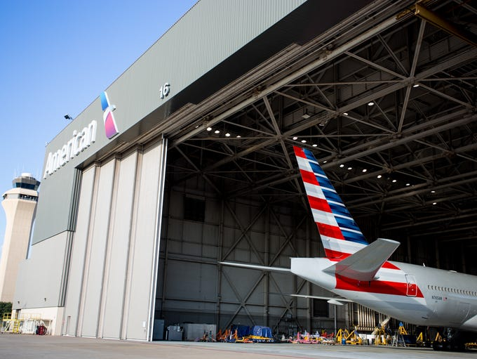 The tail of an American Airlines Boeing 777 peeks out