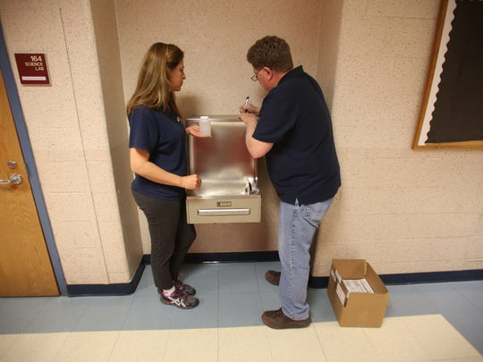 Water samples for lead testing being taken from drinking fountains at Franklin Lakes Middle School in 2016.