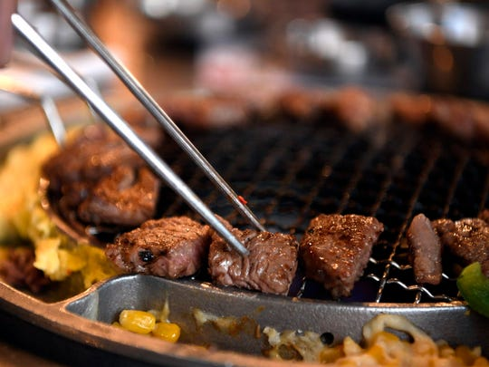 Diners can sit and watch the action up close as their rib-eye steak sizzles on the grill.