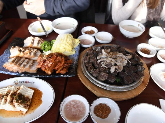Pork belly, oxtail broth, blood sausage (soondae) and the usual side offerings at Moo Bong Ri.