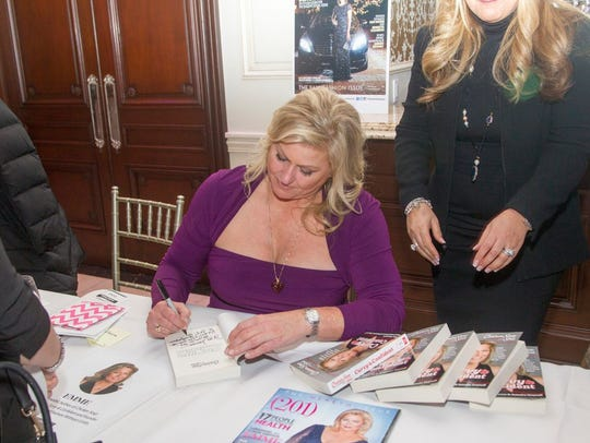 Supermodel Emme signs copies of (201) during the eighth Women for Women event at The Terrace in Paramus.