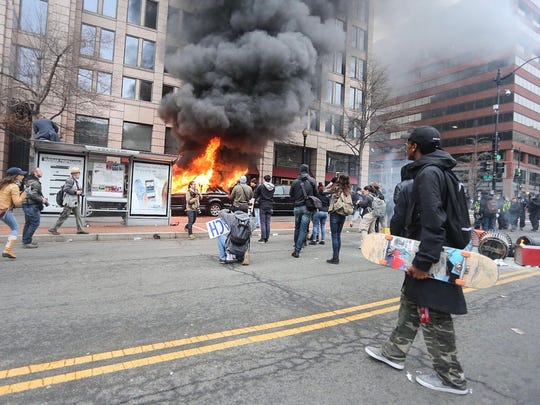 A limousine burns during protests in Washington, D.C., on Inauguration Day. Amanda J. Cain photo.