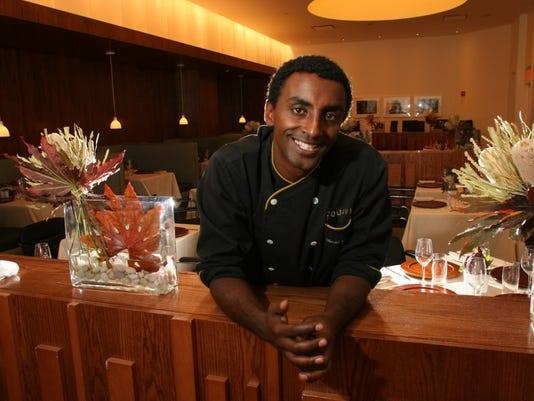 Marcus Samuelsson, chef and owner of Aquavit, a Scandinavian restaurant in Manhattan, has written a book about exploring the cuisine of Africa, his birthplace (he was adopted by a Swedish family at age 3). We're looking for a portrait of Marcus in his resturant kitchen. If he is too busy for a portrait, a photo of him working in his kitchen will be suitable.