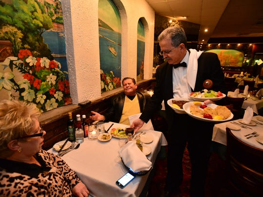 The position of host, server or cook is no longer deemed a supporting role. Waiters such as John Pataris (presenting dinner to Nunzio Santucio and Jayne Thorne at Angelo's in Lyndhurst) have skills and knowledge crucial to a restaurant's success.