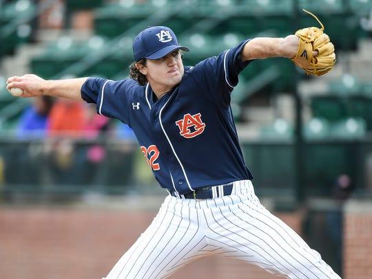 Casey Mize pitches last season.
