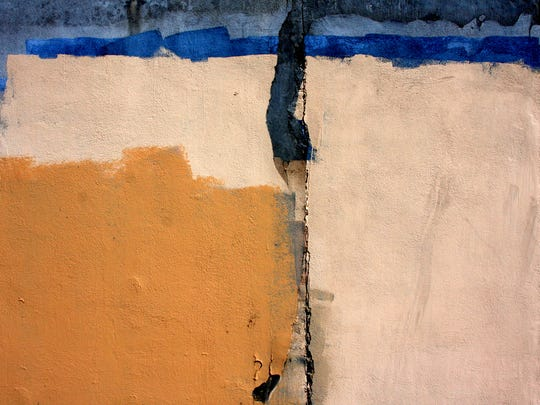 A photograph of a buffed wall taken behind Big Lots in Las Cruces in 2009 by local photographer Mattie Kannard.