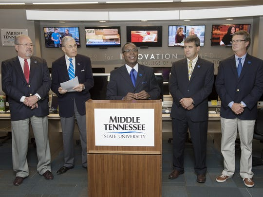 MTSU President Sidney A. McPhee, center, gives remarks during Friday's announcement of the creation of the Tennessee Journalism Hall of Fame. Joining McPhee are, from left, Ron Fryar, publisher of the Murfreesboro Post and Cannon Courier; John Hood, MTSU director of Community Engagement; Peter Demos, board chairman for the Rutherford County Chamber of Commerce; and Murfreesboro Mayor Tommy Bragg. MTSU photo by Andy Heidt MTSU President Sidney A. McPhee, center, gives remarks during Friday's announcement of the creation of the Tennessee Journalism Hall of Fame, which will be located in MTSU's Center for Media Innovation in the John Bragg Mass Communication Building. Joining McPhee are, from left, Ron Fryar, publisher of the Murfreesboro Post and Cannon Courier; John Hood, MTSU director of Community Engagement; Peter Demos, board chairman for the Rutherford County Chamber of Commerce; and Murfreesboro Mayor Tommy Bragg. (MTSU photo by Andy Heidt)