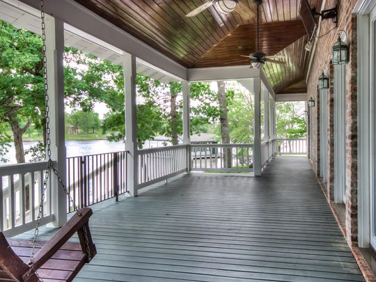 The home features a wrap-around porch.