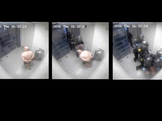 These screen shots show the Washoe County sheriff's Detention Response Team bursting into Justin Thompson's cell.