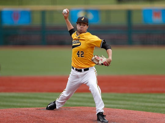 Drake Robison throws a pitch in Sunday's 13-4 win over Northwestern at the Big Ten Tournament in Bloomington, Ind.
