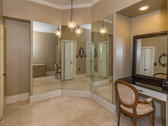 The master bath includes his and her closets.
