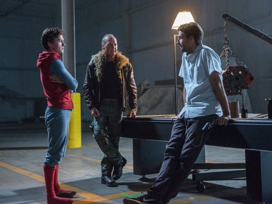 (l to r) Tom Holland, Michael Keaton, and director Jon Watts on the set of Columbia Pictures' SPIDER-MAN™: HOMECOMING. ©CTMG. CR: Chuck Zlotnick.