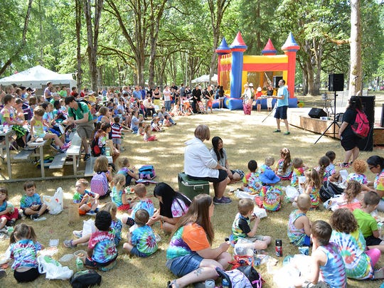 Families watch entertainment at the Family Stage at