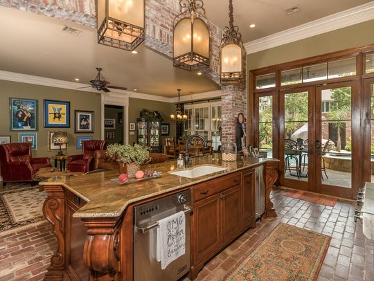 The kitchen is open to the living areas with views