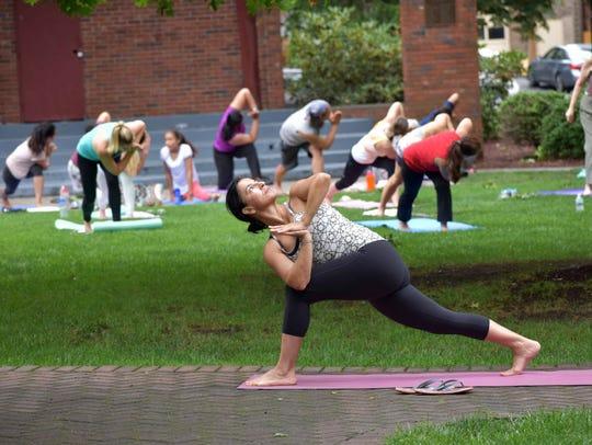 A yoga session, hosted by Shiva Shanti Yoga School,