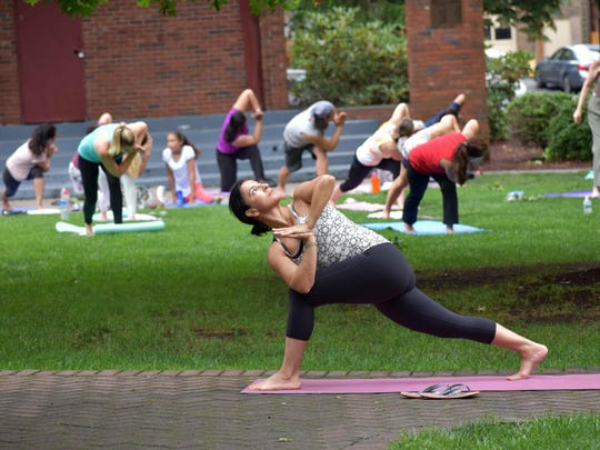 A yoga session, hosted by Shiva Shanti Yoga School, at the Hutzel Memorial Bandshell in Rutherford.